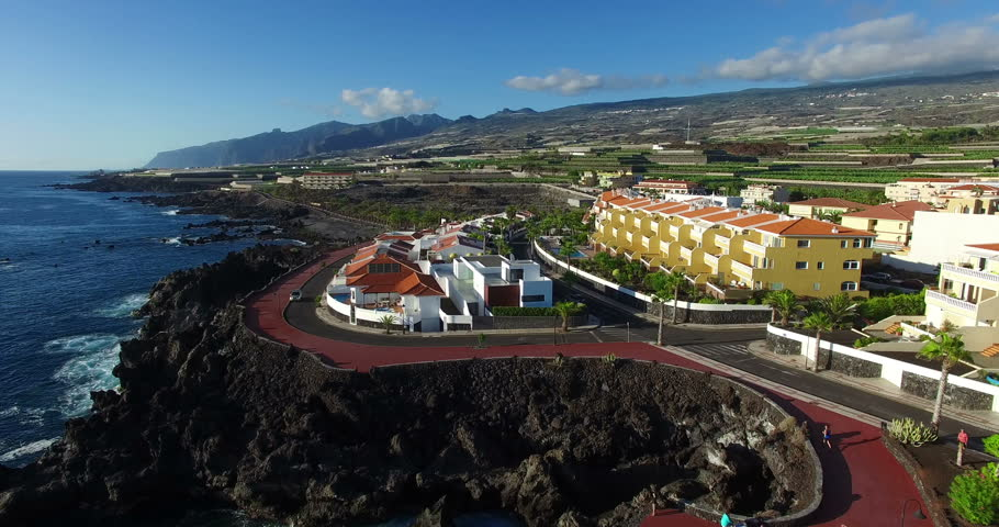 AERIAL. Flight above North Atlantic ocean coast. Playa San Juan, Tenerife island, Spain