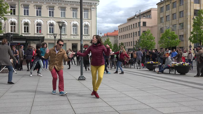 VILNIUS, LITHUANIA - MAY 16: Young people in pairs dance lindy hop in outdoor street on May 16, 2015 in Vilnius, Lithuania. Street music day. Static shot. 4K - 4K stock footage clip