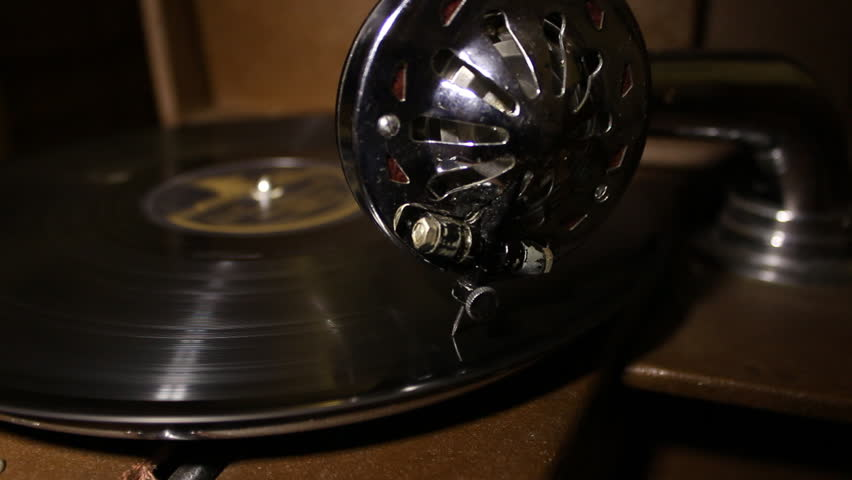 Gramophone Disc Rotates and Stops.