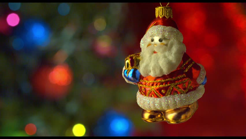 christmas santa toy decor with new year tree lights twinkling
