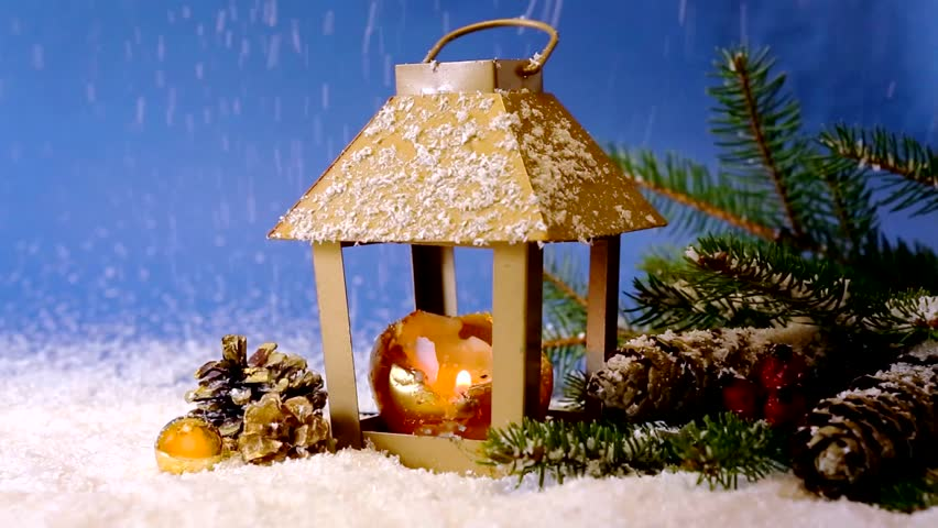 Christmas decoration with lantern ,snow and fir tree branch.Winter latern isolated on blue background.Christmas lantern and snowfall. - HD stock footage clip