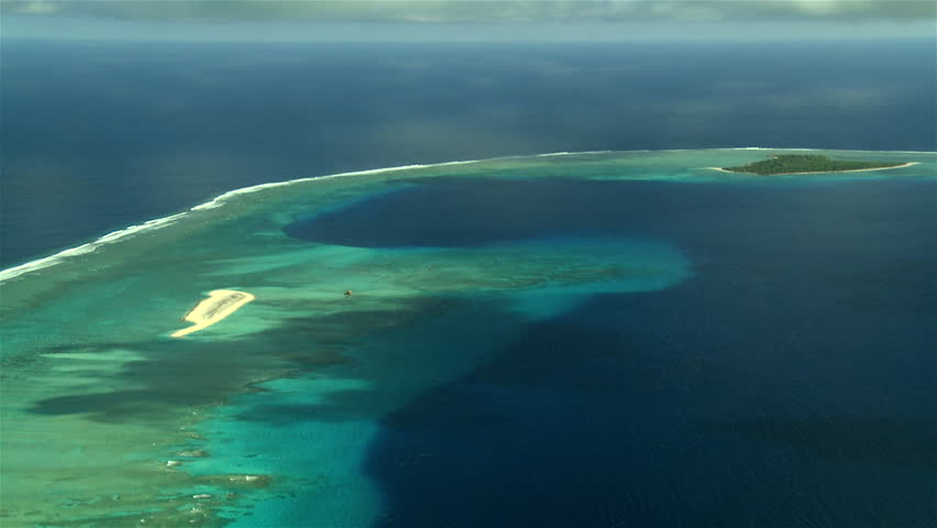 Rare footage showing aerial view Bikini Atoll and lagoon, showing large circular crater of H-bomb Castle Bravo | Shutterstock HD Video #12600143