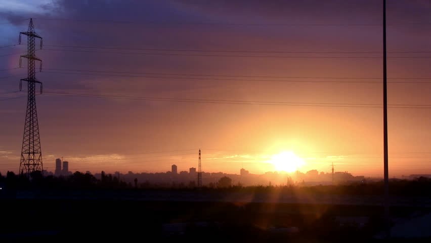 Beauty Sunset with city in the background. Electric Antenna in the frame