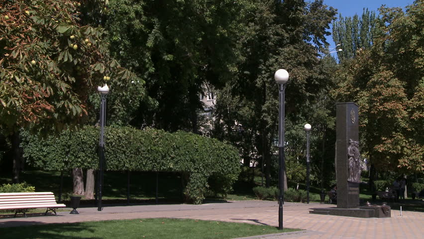 City park in summer. View of statue and lights - HD stock video clip