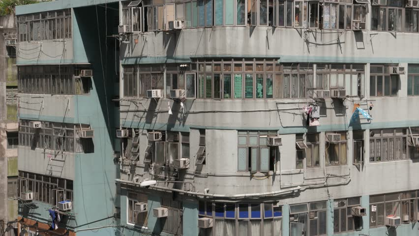Hong Kong street view. House with hanging laundry. Kowloon October 2015. 4K resolution.  Flat profile without color correction. Visit my portfolio for color graded version. | Shutterstock HD Video #12657572