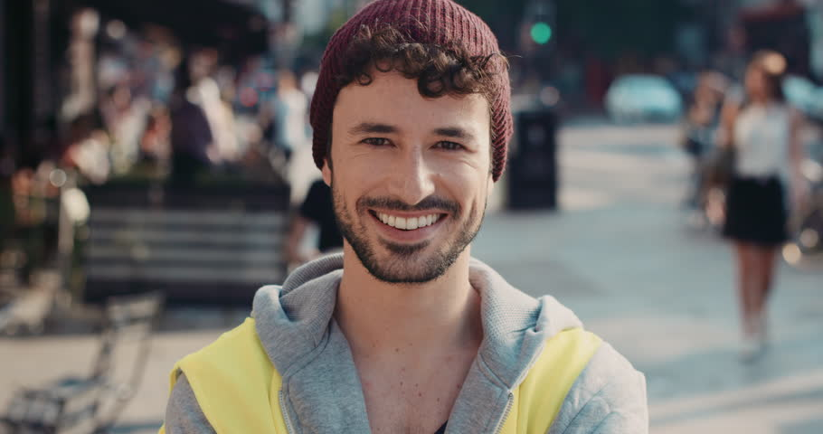 Slow Motion Portrait of builder wearing high visibility jacket caucasian man smiling in city real people series | Shutterstock HD Video #12665744