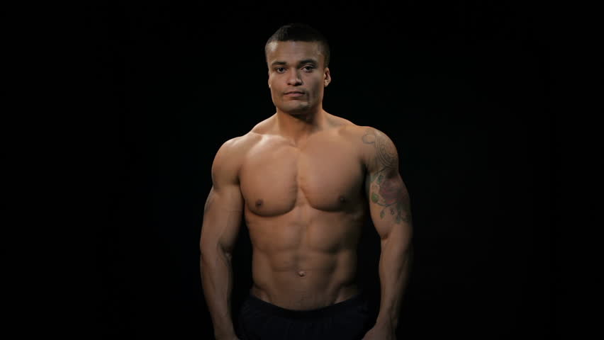 Strong, Muscular Guy On A Black Background Stock Photo