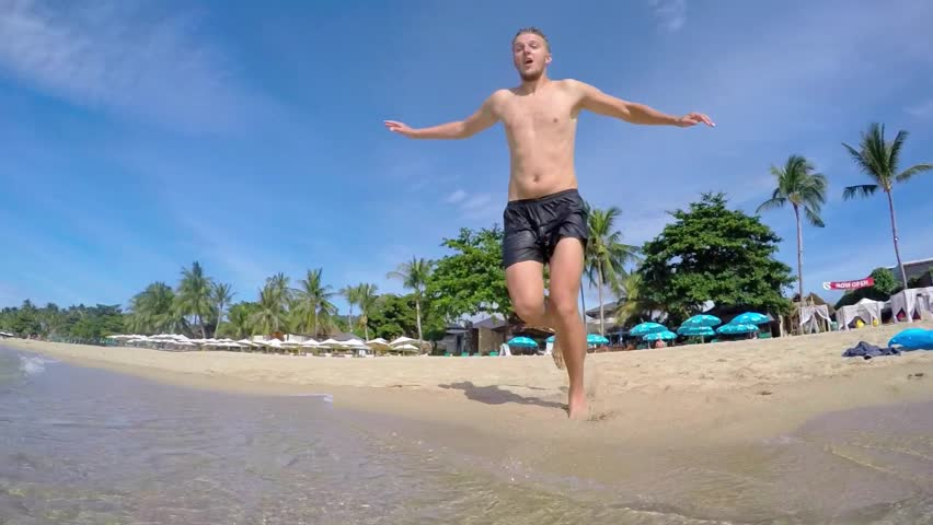 Man Jumping in Sea on Summer Vacation. Slow Motion. HD, 1920x1080. - HD stock footage clip