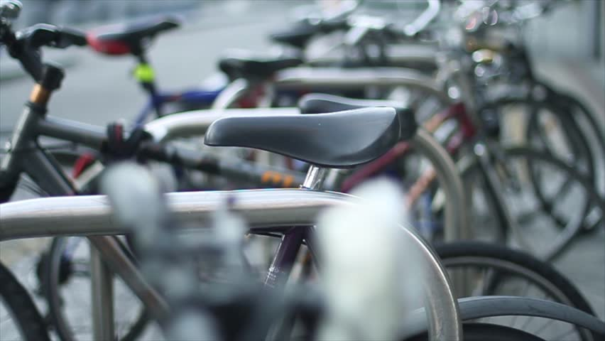 Close up shot, public bicycle parking focus movement - HD stock video clip