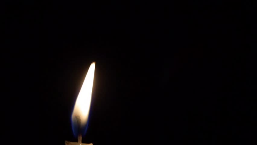 Magic trick with candle flame, physical phenomenon, on black background - HD stock footage clip
