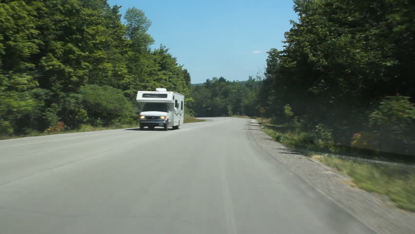 Passing a recreation camper on a rural road. Ontario, Canada.