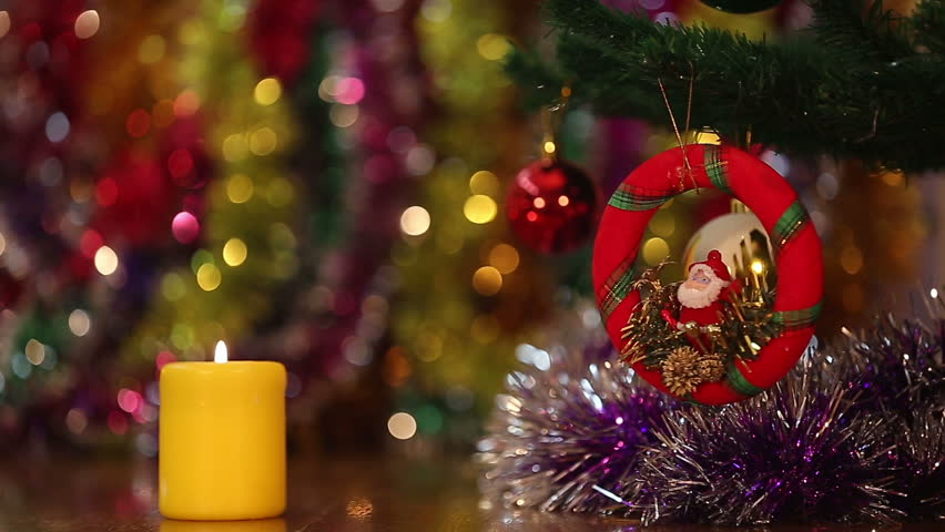 Christmas background with Santa and a burning candle