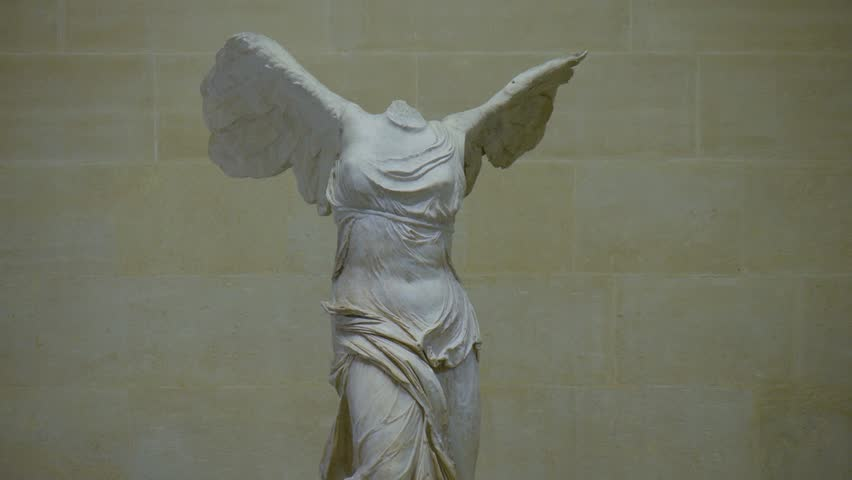 Paris, France - October, 2015 - Tilting shot of the Winged Victory of Samothrace statue in the Muse Louvre.