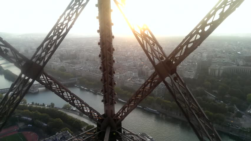 Wonderful view of Paris from moving Eiffel Tower lift in sunrise or sunset light | Shutterstock HD Video #12823766