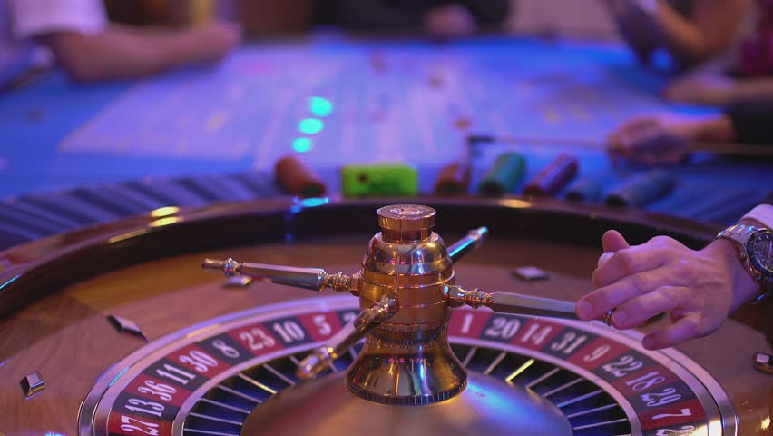 Roulette table in a casino - spinning wheel - ball lands on field 9 red | Shutterstock HD Video #12838202