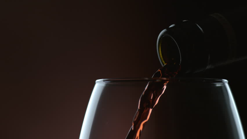 Cinemagraph - Wine pouring in slow motion. Looping Motion Photo.