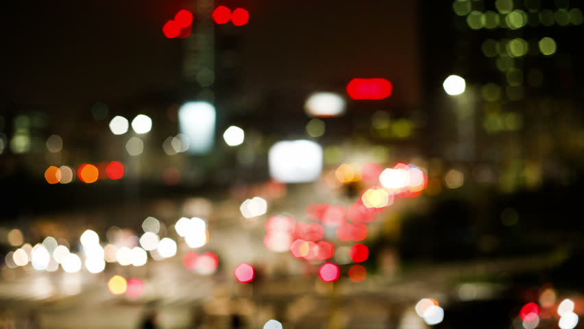 time lapse blurred and out of focus  of traffic,  lights and colors in a big busy city