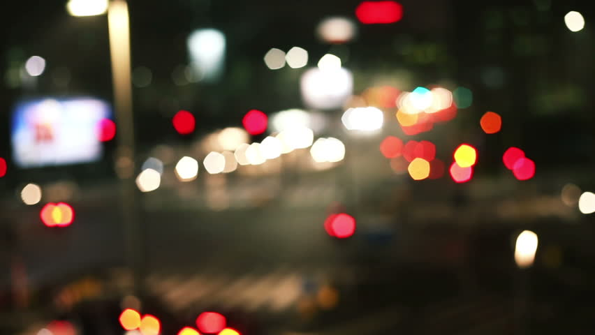 shot of bokeh and out of focus cars in the traffic, big city