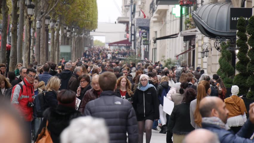 Paris, France - October, 2015 - Slow motion shots of crowds of people walking down Champs-lyse.
