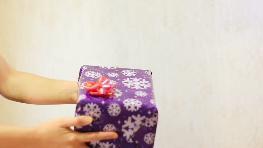 Male hand pass in the box gift box female hands, Christmas and New Year, blue box | Shutterstock HD Video #12904991