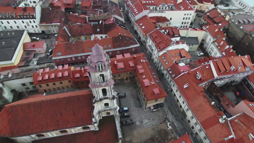 AERIAL. Smooth flight around beautiful abandoned Blessed Virgin Mary of Consolation church in Vilnius old town, Lithuania