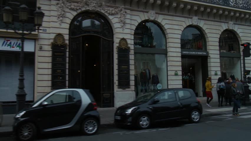 Paris, France - October, 2015 - Wide shot of Place de l'Opera viewed from a car.Paris, France - October, 2015 - Wide shot of Place de l'Opera viewed from a car.