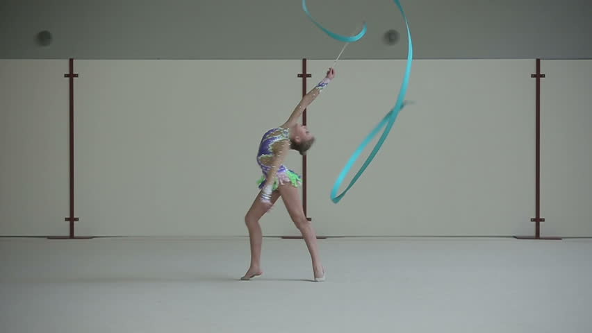 Rhythmic gymnastics: Girl training a gymnastics exercise with a ribbon. Slow motion