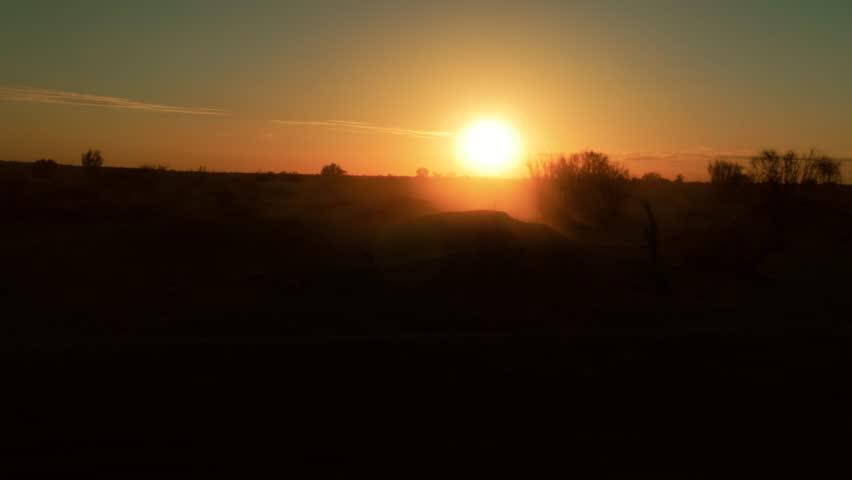 camera car in the sahara desert at sunset