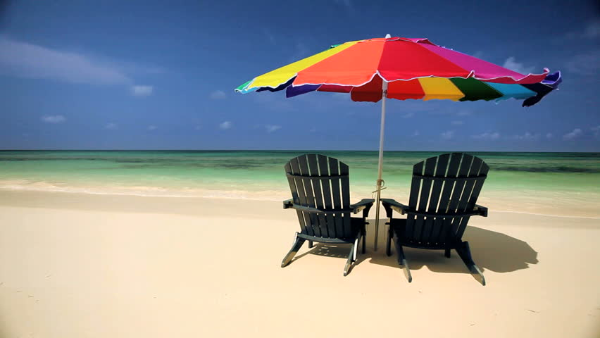 sun parasol easy chairs on the beach on a paradise. Black Bedroom Furniture Sets. Home Design Ideas