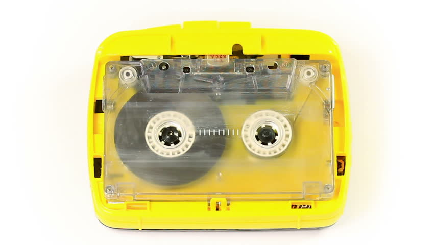 Yellow vintage audio cassette player with a tape playing in. Cassette tape player recording or playing.