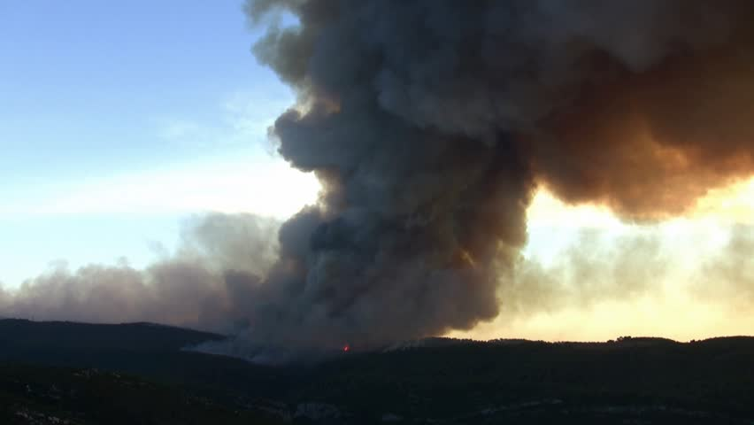Huge cloud of smoke sunset; horrific fire destroys thousands of acres of trees - HD stock video clip