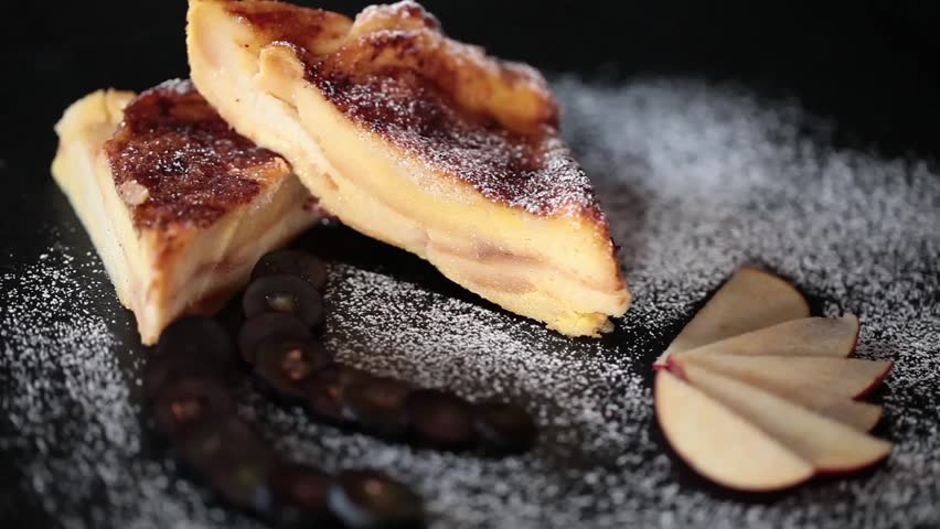 Eating bread and butter pudding, close up video clip.