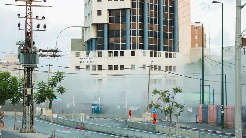 TEL AVIV, ISRAEL - AUGUST 15: Old Landmark Maariv bridge demolished in huge controlled explosion, Tel Aviv, Israel. With Sound
