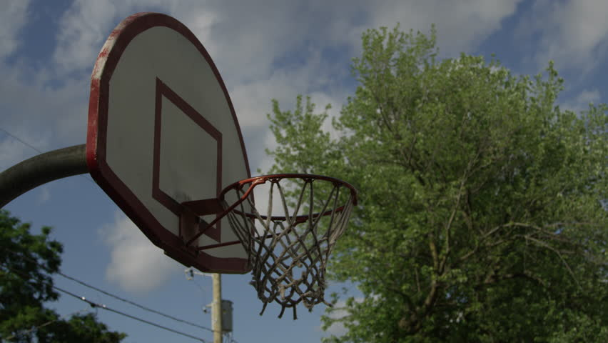Unidentifiable players dribbling, walking and shooting basket balls in an urban setting | Shutterstock HD Video #13080896