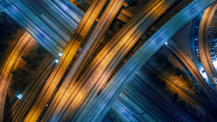 Static vertical top down aerial view of traffic on freeway interchange at night. 4K UHD timelapse background | Shutterstock HD Video #13085963