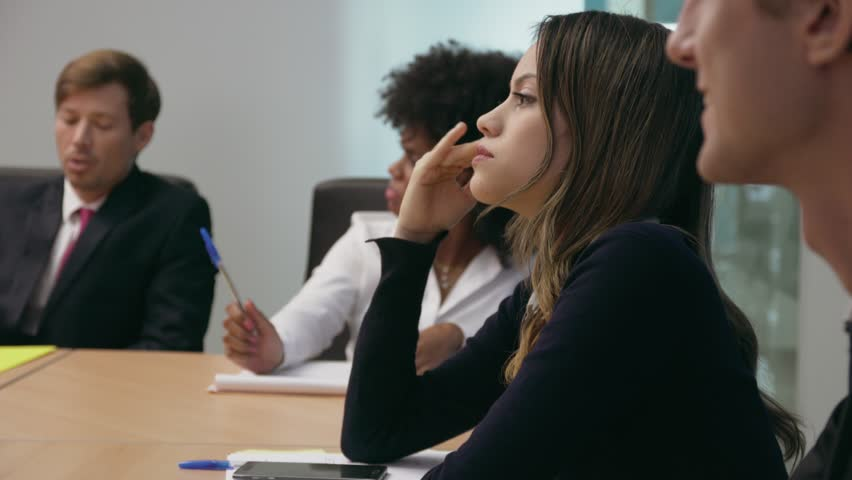 Group of business people during meeting in corporate conference room. A woman gets a headache and touches her temples. Medium shot | Shutterstock HD Video #13091543