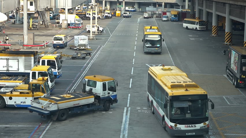 Airport luggage vehicle, bus and truck parking area in airpot.   Shutterstock HD Video #13091723