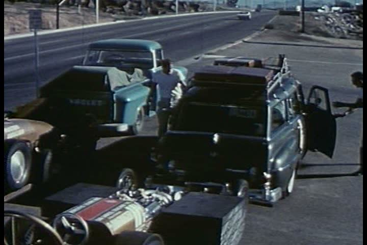 CIRCA 1950s - A hot rod is inspected on a trailer at a meet up point in the 1950s. - SD stock footage clip