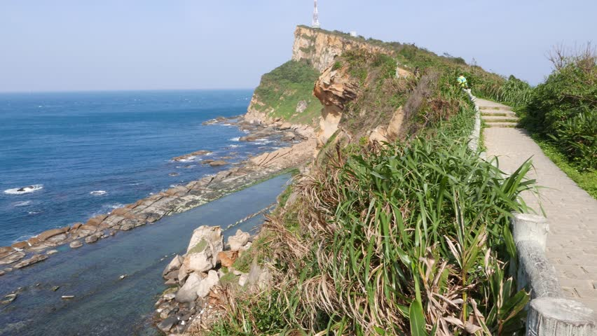 Fallen sink ridge view from cliff, bird's eye height rocky shore scenery. Yehliu Geopark, popular sightseeing place in Taiwan. Yeh-Liou is a cape on north coast of Taiwan in Wanli town #13143122