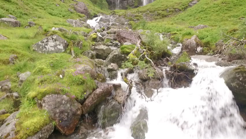 Stunning aerial / drone shot of a waterfall in Glencoe in the Scottish highlands - HD stock footage clip