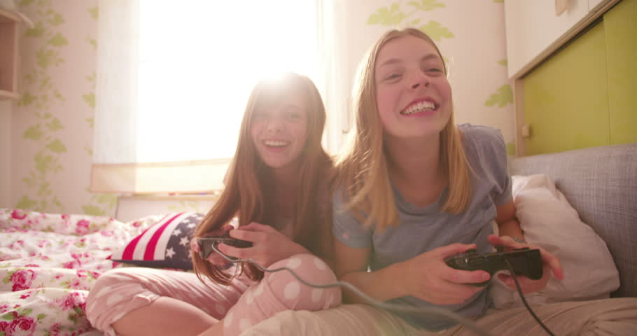 canded movies of teen girls on bed