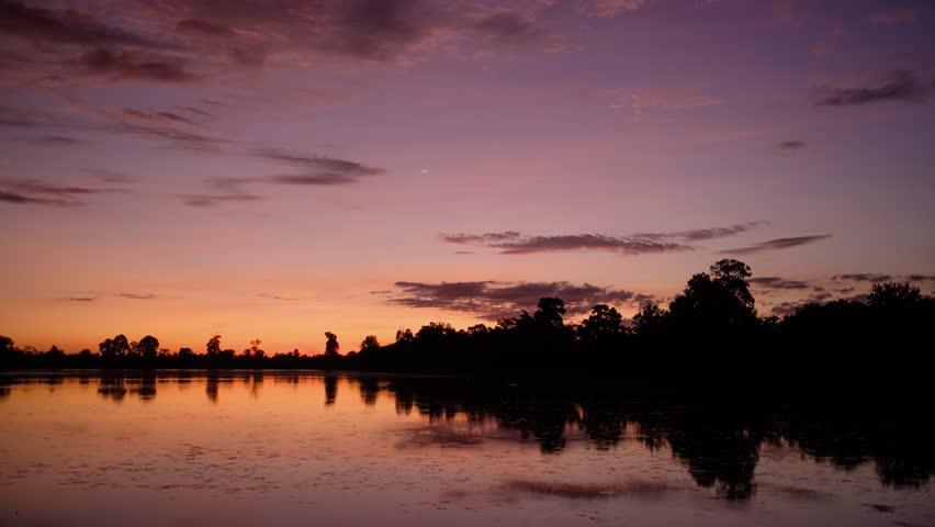 4k UHD sunset time-lapse in Srah Srang. Angkor. Siem Reap. Cambodia