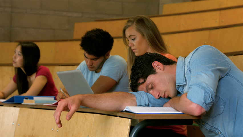 Students sitting beside each other while learning in college | Shutterstock HD Video #13212827
