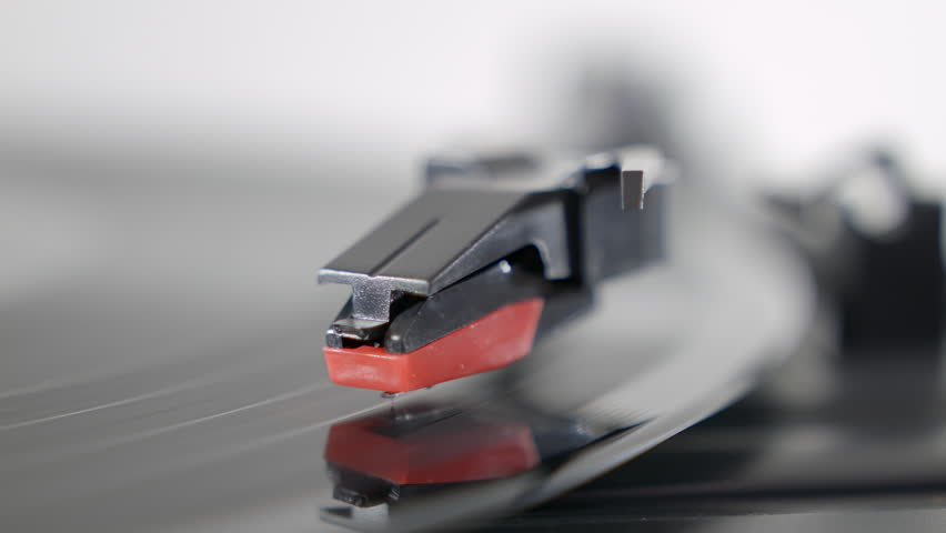 Record player turntable HD stock footage. A record player turntable with it's stylus running along a vinyl record | Shutterstock HD Video #13219874