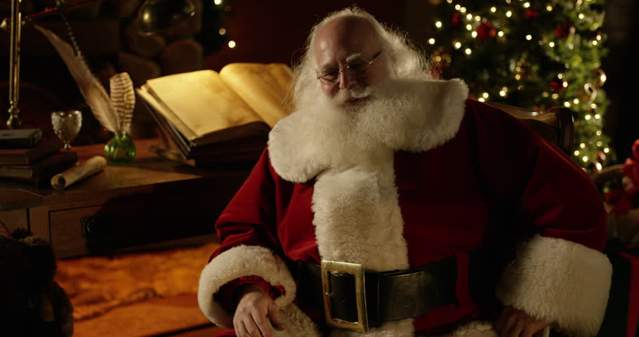 Santa Claus laughs at camera with a perfectly decorated Christmas Home ... Naughty Santa Claus Costume For Men