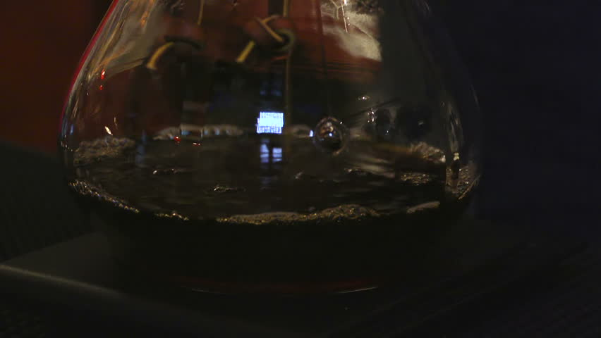 Cafe. Chemex Coffee brewing. Pouring hot water. Filtering coffee - HD stock video clip