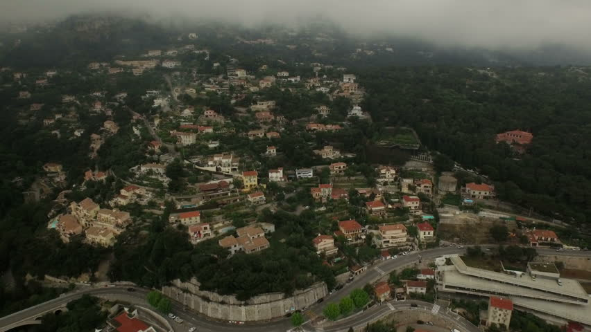 Monaco Aerial v7 Flying low up hillside neighborhood and back towards downtown. - 4K stock footage clip