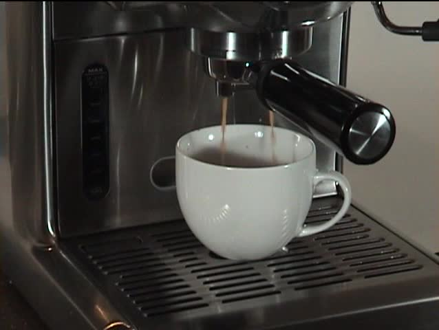 cappuccino machine is making  a cap of coffee - SD stock video clip