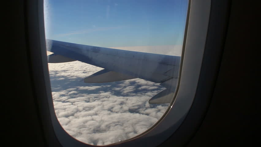Airplane Window Seat View Of Wing Of Plane On Flight