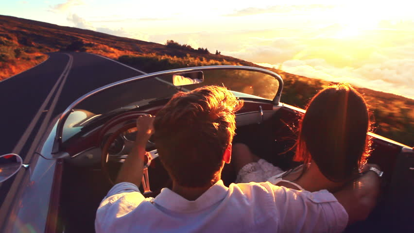 Happy Couple Driving on Country Road into the Sunset in Classic Vintage Sports Car - HD stock video clip